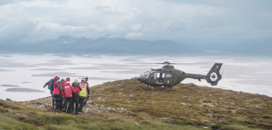 Mountain Rescue carry a casualty towards an Air Corps helicopter to be airlifted off Croagh Patrick.